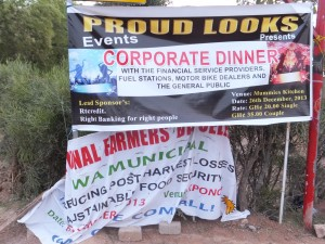 "Signs of the times: Here a banner advertising festivities for the annual Farmer's Day sags and crumples below a banner advertising a ""corporate dinner"""